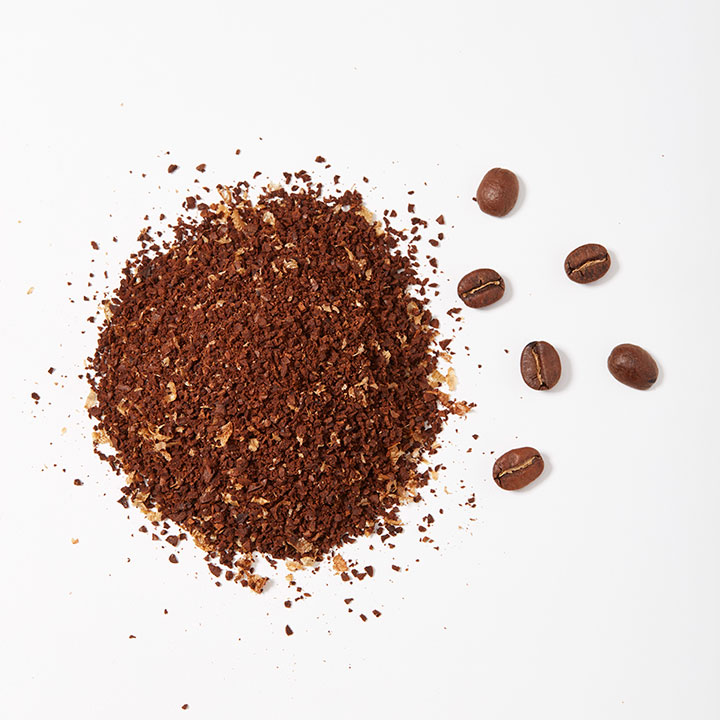 Coarsely ground coffee shown next to whole beans