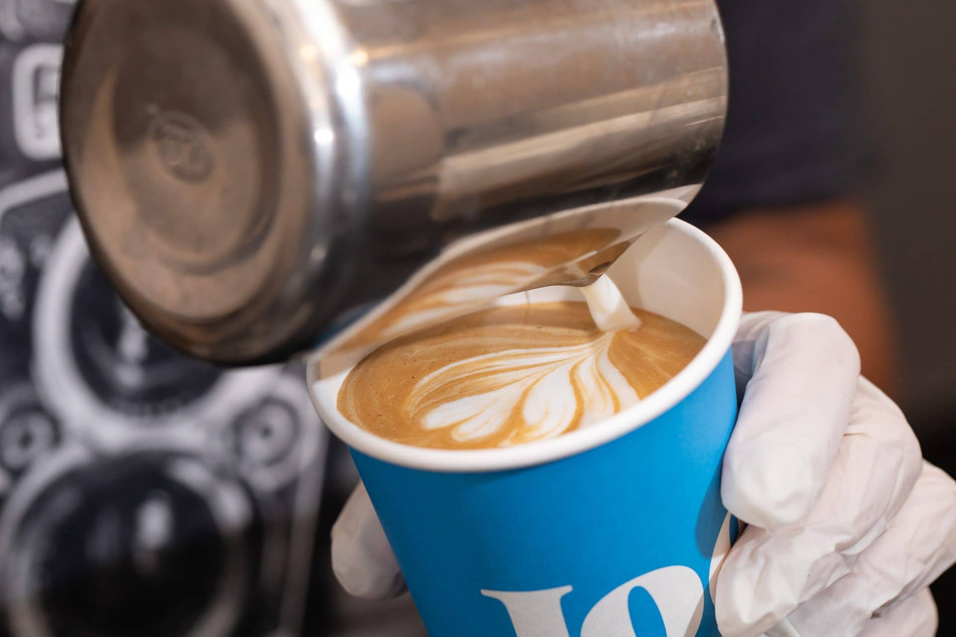 Pouring latte art into a Joe Coffee cup