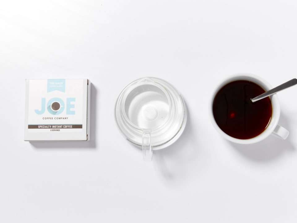instant coffee box, water, cup of coffee