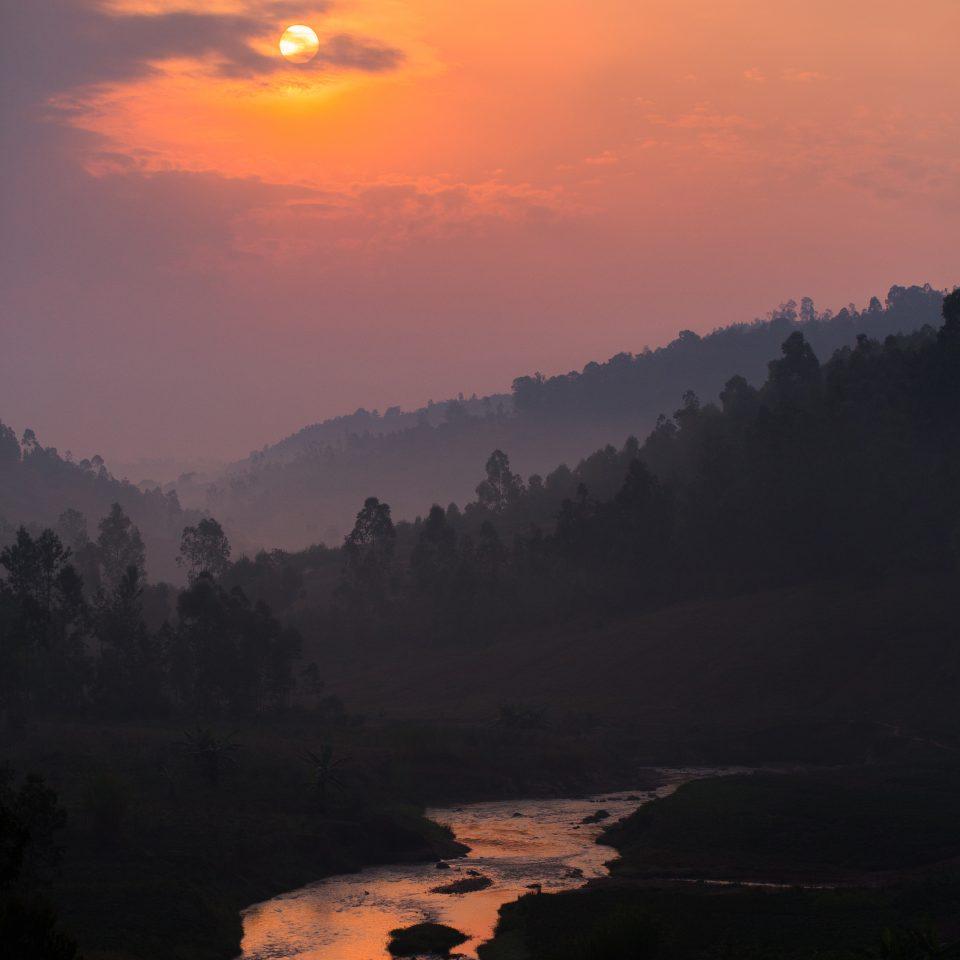 River aglow under the setting sun over Ninga Hill, Burundi