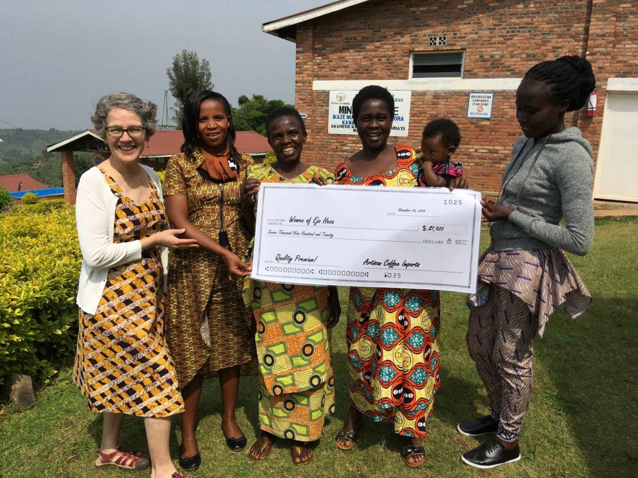 Ruth Ann Church presents a check to Ejo Heza
