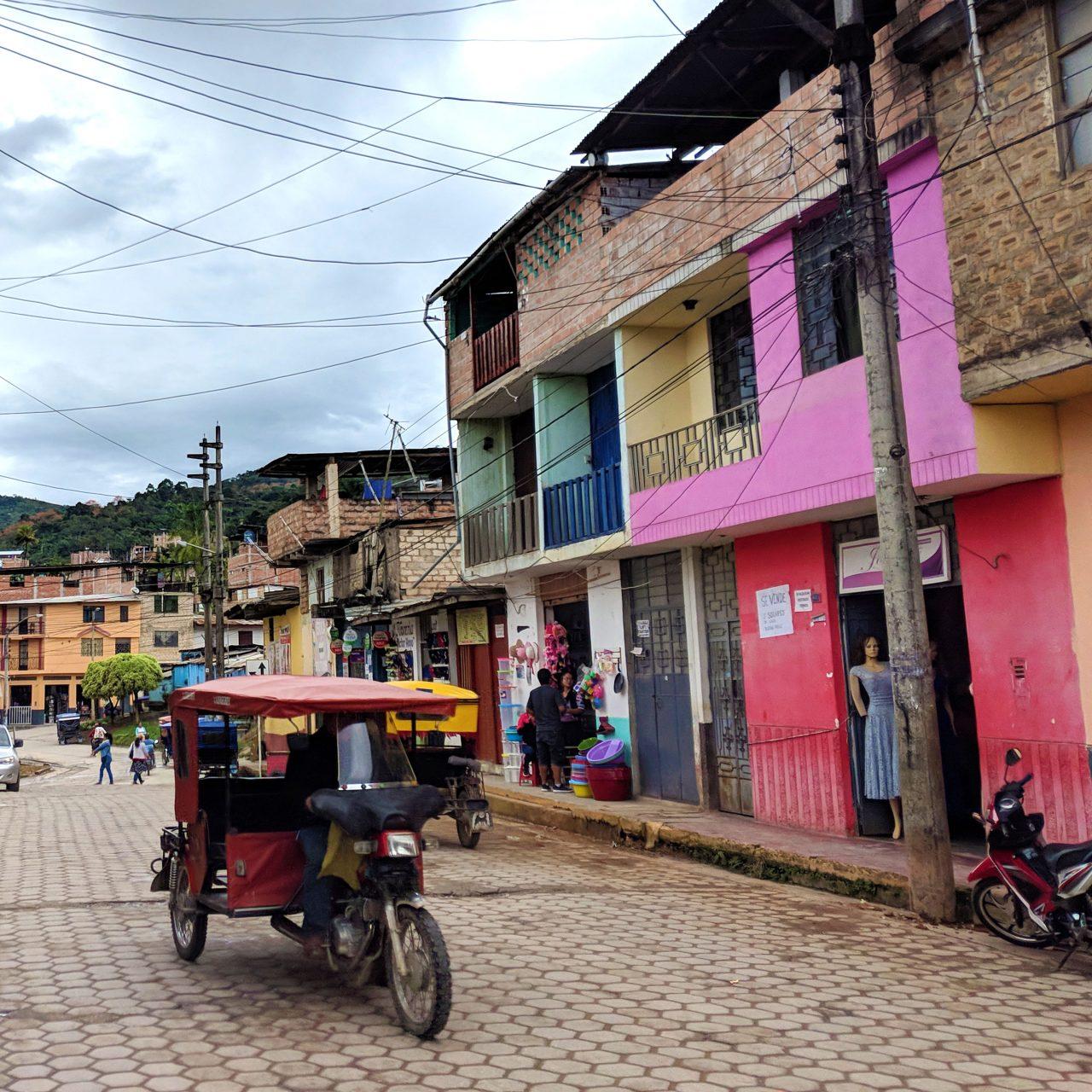 A colorful street scene in the Cajarmarca region of Peru