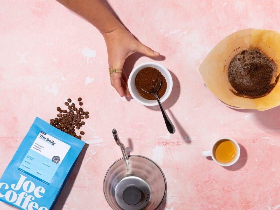 hand grabbing ground coffee
