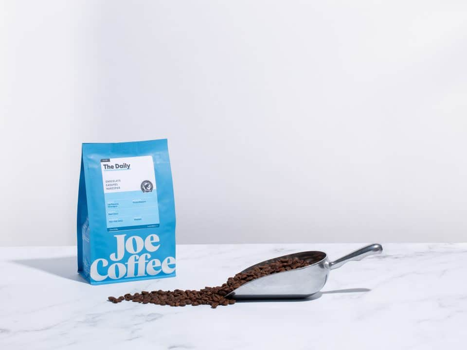 coffee bag and beans in scooper