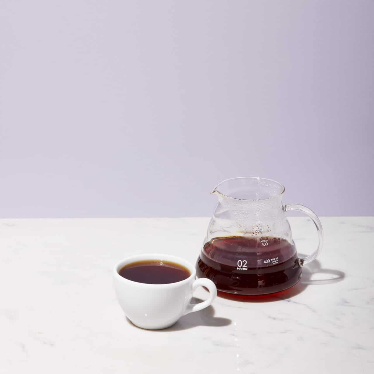 Hario Range Server with a cup of brewed coffee