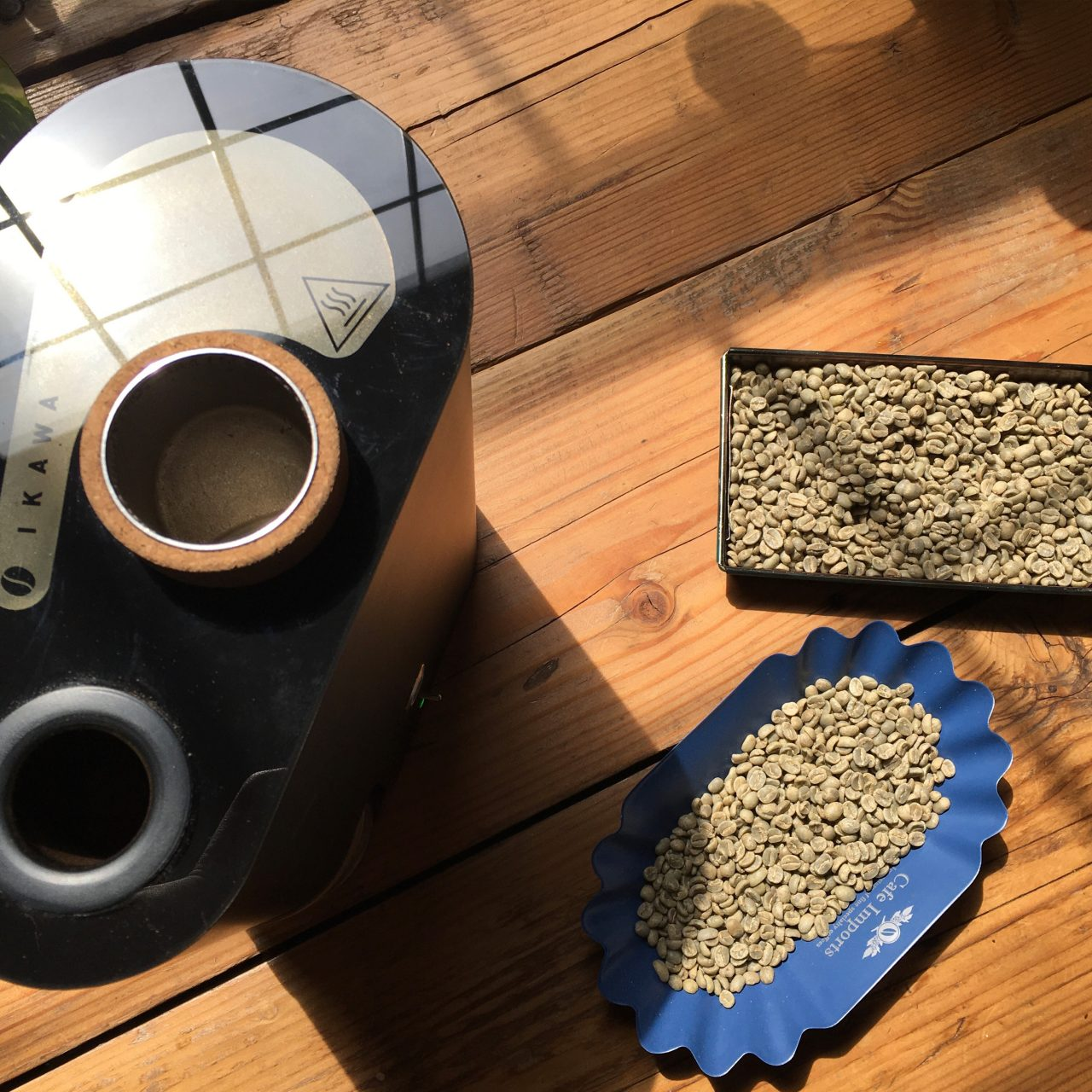 Ikawa roaster with green coffee beans